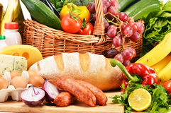 Assorted grocery products including vegetables fruits wine bread Royalty Free Stock Image