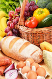 Assorted grocery products including vegetables fruits wine bread Royalty Free Stock Images