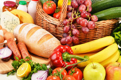 Assorted grocery products including vegetables fruits wine bread Royalty Free Stock Photos