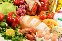 Assorted grocery products including vegetables fruits wine bread Royalty Free Stock Photo