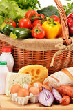 Assorted grocery products including vegetables fruits wine bread Stock Photo