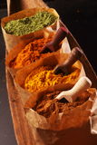 Assorted ground spices in brown paper bags Royalty Free Stock Photo