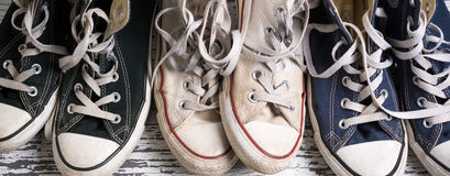Assorted group of canvas, retro tennis shoes Royalty Free Stock Photo