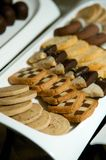 Assorted hand dipped tarts and cookies Royalty Free Stock Photos