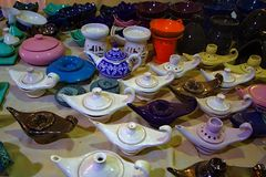OIl lamps and pottery. Assorted handmade pottery products including oil lamps, ashtray, and aroma oil burners stock images