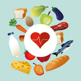 Assorted healthy food and heart cardiogram icons image Royalty Free Stock Photo