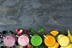 Free Assorted Healthy Fruit Smoothies, Top View Bottom Border Against A Dark Background Stock Photography - 169542342