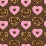 Assorted heart shaped doughnuts. Glazed with chocolate and pink icing topped with colourful sprinkles arranged in a seamless background pattern of repeat rows Stock Photography