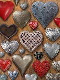 Assorted hearts on wood background Royalty Free Stock Photos