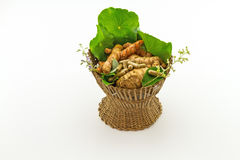 Assorted of herbal in brown bamboo basket   isolate on white background Stock Photography