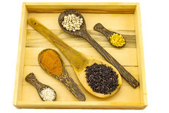 Assorted  herbal medicine in wooden spoon and  wood box  isolate Royalty Free Stock Photo