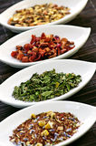 Assorted herbal wellness dry tea in bowls Stock Photo