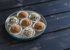 Assorted homemade candy - dark chocolate truffles with nuts and cocoa Stock Images