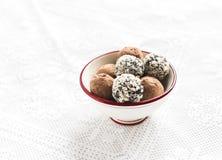 Assorted homemade dark chocolate truffles in a white ceramic bowl Stock Photography