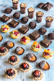 Assorted homemade mini cakes on the table Royalty Free Stock Photo