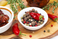 Assorted hot peppers in a bowl and fresh chili peppers Stock Image