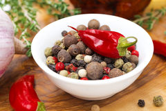 Assorted hot peppers in a bowl and fresh chili peppers, close-up Royalty Free Stock Photography