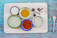 Assorted hot spicy powders in ceramic bowls Stock Image
