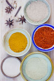 Assorted hot spicy powders in ceramic bowls Stock Photography