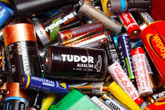 Assorted Household Batteries in garbage can Stock Images