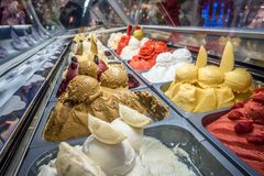 Assorted ice cream on display in store. Assorted ice cream on display in  store stock photos