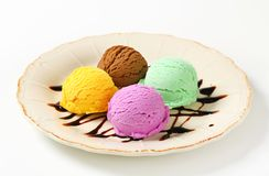 Assorted ice cream. Scoops of ice cream garnished with chocolate syrup Royalty Free Stock Images