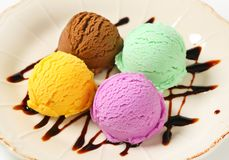 Assorted ice cream. Scoops of ice cream garnished with chocolate syrup Royalty Free Stock Photo
