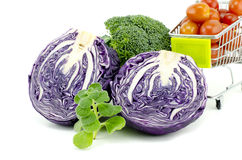 Assorted image of raw and fresh vegetables.purple cabbage, cherry tomatoes on trolley, green mint and broccoli Stock Image