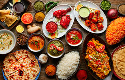 Assorted Indian recipes food various. With spices and rice on wooden table Royalty Free Stock Photos