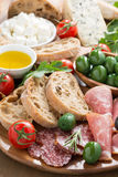 Assorted Italian antipasti - deli meats, fresh cheese, olives Stock Image