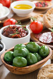 Assorted Italian antipasti - olives, pickles and bread, close-up Royalty Free Stock Images