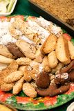 Assorted Italian Cookies. In a plate among other deserts on a table for Christmas Stock Images