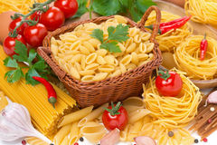 Assorted Italian pasta, cherry tomatoes, herbs and spices Royalty Free Stock Photography