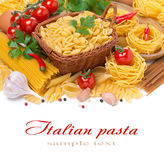 Assorted Italian pasta, cherry tomatoes, herbs, spices isolated Royalty Free Stock Photography