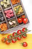 Assorted Italian pasta and spaghetti tomatoes in  wooden box Stock Photography
