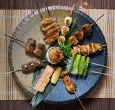 Assorted Japanese Kushiyaki, Skewered and Grilled Meat Stock Photos