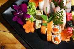 Assorted japanese sushi on a black plate. Royalty Free Stock Photos