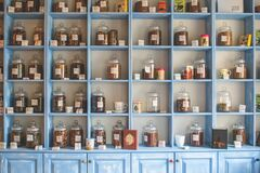 Assorted Jars on Blue Shelf Cabinets Stock Photo