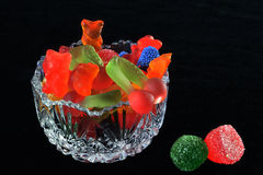 Assorted jelly. Sweet jelly in a vase on the table  on a dark background Royalty Free Stock Images