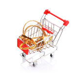 Assorted jewelleries in shopping cart isolated Stock Photos
