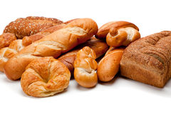 Assorted kinds of breads on a white background Stock Photography