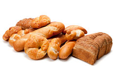 Assorted Kinds Of Breads On A White Background Royalty Free Stock Photos