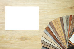 Assorted kitchen counter samples fanned out isolated on white ba. Installing laminate floor and wood samples Stock Images