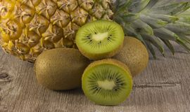 Assorted kiwi and pineapple stock images