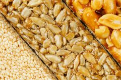 Assorted kozinaki, sweets from sunflower seeds, sesame and peanuts filled with brilliant glaze. Macro royalty free stock photo