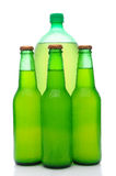 Assorted Lemon Lime Soda Bottles. A two liter plastic lemon lime soda bottle behind three small glass bottles. Vertical format over white with reflection Royalty Free Stock Photography