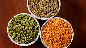 Assorted lentils rotating on wooden background