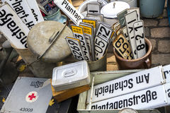 Assorted license plates and street signs in Berlin market Stock Images