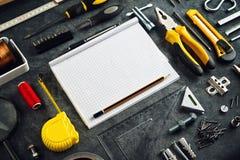 Assorted lo hace usted mismo las herramientas y cuaderno Fotografía de archivo