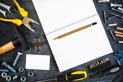 Assorted lo hace usted mismo las herramientas y cuaderno Imagen de archivo libre de regalías